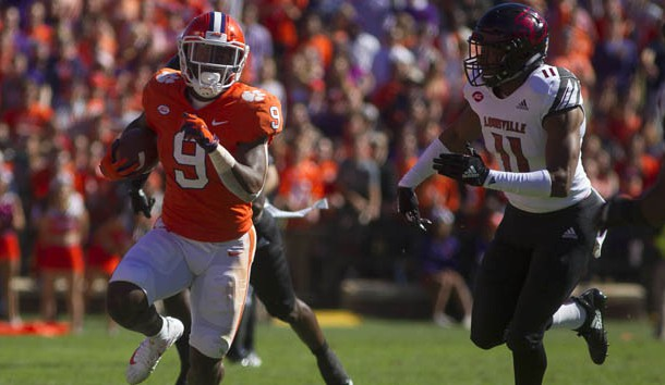 Nov 3, 2018; Clemson, SC, USA; Clemson Tigers running back Travis Etienne (9) avoids a tackle from Louisville Cardinals safety Dee Smith (11) during the first half at Clemson Memorial Stadium. Photo Credit: Joshua S. Kelly-USA TODAY Sports