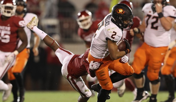 Nov 10, 2018; Norman, OK, USA; Oklahoma State Cowboys wide receiver Tylan Wallace (2) is tackled by Oklahoma Sooners cornerback Parnell Motley (11) during the second half at Gaylord Family - Oklahoma Memorial Stadium. Photo Credit: Kevin Jairaj-USA TODAY Sports