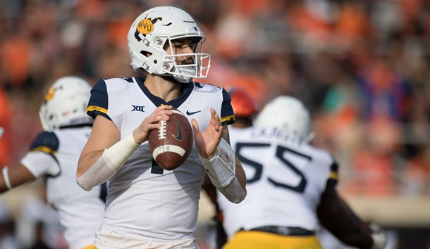 Nov 17, 2018; Stillwater, OK, USA; West Virginia Mountaineers quarterback Will Grier (7) looks to pass against the Oklahoma State Cowboys during the first quarter at Boone Pickens Stadium. Photo Credit: Rob Ferguson-USA TODAY Sports