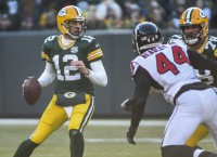 Rodgers back at practice, unsure about preseason PT