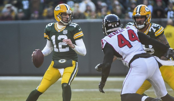 Dec 9, 2018; Green Bay, WI, USA;  Green Bay Packers quarterback Aaron Rodgers (12) looks to pass while under pressure from Atlanta Falcons linebacker Vic Beasley Jr. (44) in the second quarter at Lambeau Field. Photo Credit: Benny Sieu-USA TODAY Sports