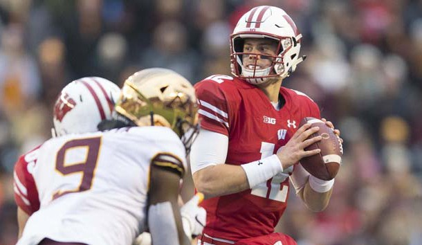 Nov 24, 2018; Madison, WI, USA; Wisconsin Badgers quarterback Alex Hornibrook (12) looks to pass the football during the second quarter against the Minnesota Golden Gophers at Camp Randall Stadium. Photo Credit: Jeff Hanisch-USA TODAY Sports