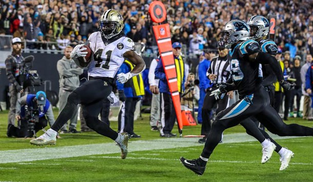 Dec 17, 2018; Charlotte, NC, USA; New Orleans Saints running back Alvin Kamara (41) runs into the end zone past Carolina Panthers free safety Mike Adams (29) during the second half at Bank of America Stadium. Photo Credit: Jim Dedmon-USA TODAY Sports
