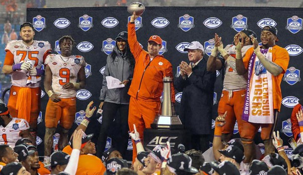 Dec 1, 2018; Charlotte, NC, USA;  Clemson Tigers head coach Dabo Swinney holds up the ACC Championship trophy after defeating the Pittsburgh Panthers in the ACC championship game at Bank of America Stadium. Photo Credit: Jim Dedmon-USA TODAY Sports