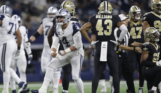 Nov 29, 2018; Arlington, TX, USA; Dallas Cowboys quarterback Dak Prescott (4) reacts after getting a first down in the fourth quarter against the New Orleans Saints at AT&T Stadium. Photo Credit: Tim Heitman-USA TODAY Sports