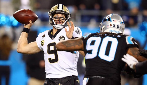 Dec 17, 2018; Charlotte, NC, USA; New Orleans Saints quarterback Drew Brees (9) looks to pass while under pressure by Carolina Panthers defensive end Julius Peppers (90) in the third quarter at Bank of America Stadium. Photo Credit: Jeremy Brevard-USA TODAY Sports