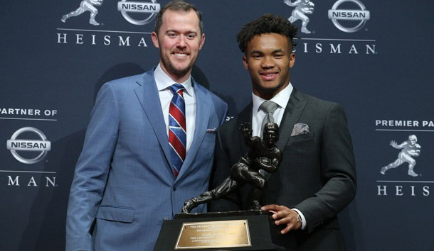 Dec 8, 2018; New York, NY, USA; Oklahoma Sooners quarterback Kyler Murray (right) poses for photos with head coach Lincoln Riley (left) during a press conference at the New York Marriott Marquis after winning the Heisman Trophy. Mandatory Credit: Brad Penner-USA TODAY Sports