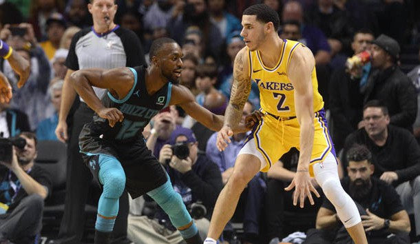 Dec 15, 2018; Charlotte, NC, USA; Los Angeles Lakers guard Lonzo Ball (2) is defended by Charlotte Hornets guard Kemba Walker (15) during the second half at the Spectrum Center. Lakers won 128-100.  Photo Credit: Sam Sharpe-USA TODAY Sports