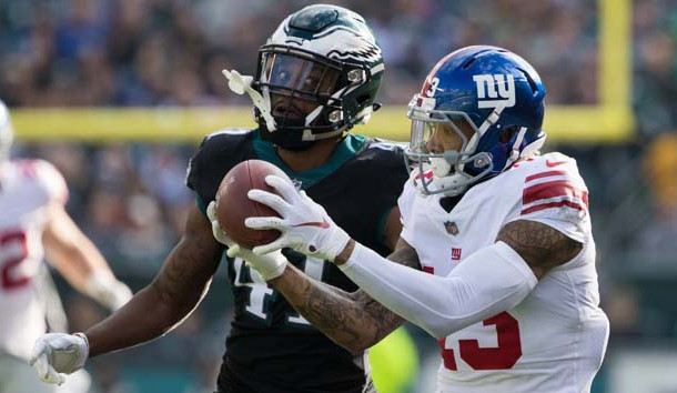 Nov 25, 2018; Philadelphia, PA, USA; New York Giants wide receiver Odell Beckham (13) makes a reception past Philadelphia Eagles cornerback DeVante Bausby (41) during the first quarter at Lincoln Financial Field. Photo Credit: Bill Streicher-USA TODAY Sports