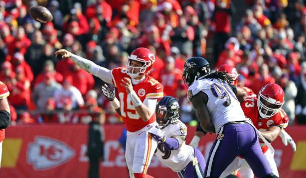 Dec 9, 2018; Kansas City, MO, USA; Kansas City Chiefs quarterback Patrick Mahomes (15) throws as he is hit by Baltimore Ravens linebacker Matthew Judon (99) in the first half at Arrowhead Stadium. Photo Credit: Jay Biggerstaff-USA TODAY Sports