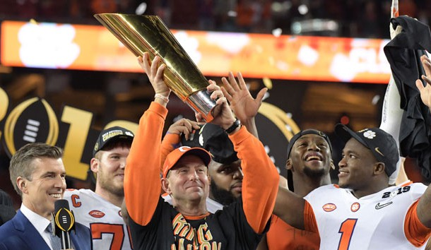 Jan 7, 2019; Santa Clara, CA, USA; Clemson Tigers head coach Dabo Swinney celebrates with the College Football Playoff National Championship trophy on the podium after defeating the Alabama Crimson Tide in the 2019 College Football Playoff Championship game at Levi's Stadium. Photo Credit: Kirby Lee-USA TODAY Sports