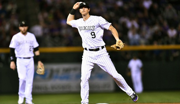 Sep 24, 2018; Denver, CO, USA; Colorado Rockies second baseman DJ LeMahieu (9) throws to first base in the fifth inning against the Philadelphia Phillies at Coors Field. Photo Credit: Ron Chenoy-USA TODAY Sports