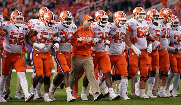 Jan 7, 2019; Santa Clara, CA, USA; Clemson Tigers head coach Dabo Swinney locks arms with his team before the 2019 College Football Playoff Championship game against the Alabama Crimson Tide at Levi's Stadium. Photo Credit: Kyle Terada-USA TODAY Sports