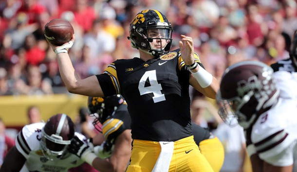 Jan 1, 2019; Tampa, FL, USA; Iowa Hawkeyes quarterback Nate Stanley (4) throws the ball against the Mississippi State Bulldogs during the second quarter in the 2019 Outback Bowl at Raymond James Stadium. Photo Credit: Kim Klement-USA TODAY Sports
