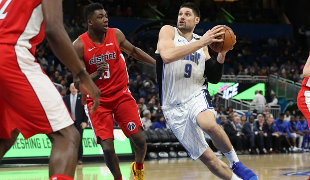 Jan 25, 2019; Orlando, FL, USA; Orlando Magic center Nikola Vucevic (9) drives to the basket as Washington Wizards center Thomas Bryant (13) defends during the second half at Amway Center. Photo Credit: Kim Klement-USA TODAY Sports