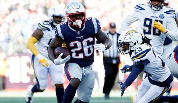 Jan 13, 2019; Foxborough, MA, USA; New England Patriots running back Sony Michel (26) rushes against Los Angeles Chargers defensive back Rayshawn Jenkins (23) during the second quarter in an AFC Divisional playoff football game at Gillette Stadium. Photo Credit: David Butler II-USA TODAY Sports