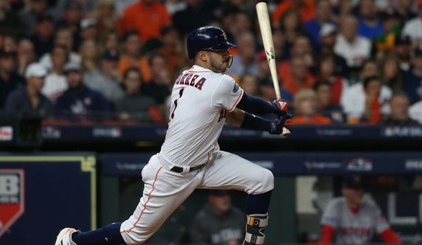 Oct 17, 2018; Houston, TX, USA; Houston Astros shortstop Carlos Correa (1) hits a RBI single in the second inning against the Boston Red Sox in game four of the 2018 ALCS playoff baseball series at Minute Maid Park. Photo Credit: Thomas B. Shea-USA TODAY Sports