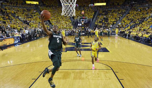 Feb 24, 2019; Ann Arbor, MI, USA; Michigan State Spartans guard Cassius Winston (5) goes to the basket in the first half against the Michigan Wolverines at Crisler Center. Photo Credit: Rick Osentoski-USA TODAY Sports