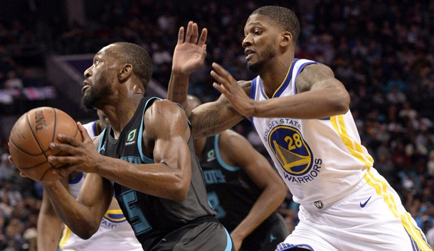 Feb 25, 2019; Charlotte, NC, USA; Charlotte Hornets guard Kemba Walker (15) drives past Golden State Warriors forward Alfonzo McKinnie (28) during the second half at the Spectrum Center. Warriors won 121-110.  Photo Credit: Sam Sharpe-USA TODAY Sports