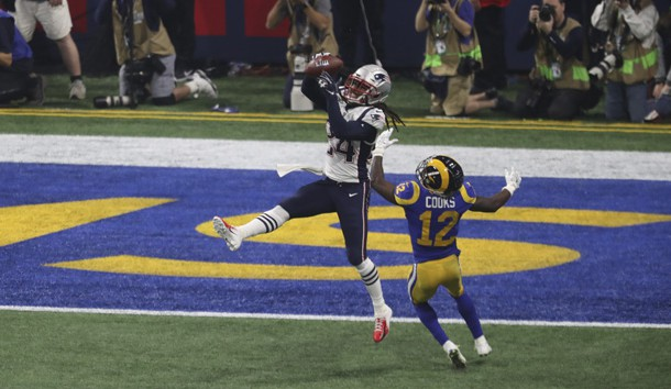Feb 3, 2019; Atlanta, GA, USA; New England Patriots cornerback Stephon Gilmore (24) intercepts a pass indented for Los Angeles Rams wide receiver Brandin Cooks (12) in Super Bowl LIII at Mercedes-Benz Stadium.  Photo Credit: Kevin Jairaj-USA TODAY Sports