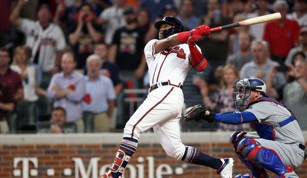 Oct 7, 2018; Atlanta, GA, USA; Atlanta Braves left fielder Ronald Acuna Jr. (13) hits a grand slam against the Los Angeles Dodgers during the second inning of game three of the 2018 NLDS playoff baseball series at SunTrust Park. Photo Credit: Brett Davis-USA TODAY Sports