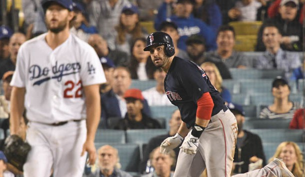 Oct 28, 2018; Los Angeles, CA, USA; Boston Red Sox outfielder J.D. Martinez (right) watches his solo home run off of Los Angeles Dodgers pitcher Clayton Kershaw (22) in the seventh inning in game five of the 2018 World Series at Dodger Stadium. Photo Credit: Robert Hanashiro-USA TODAY Sports