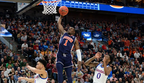 Mar 23, 2019; Salt Lake City, UT, USA; Auburn Tigers guard Jared Harper (1) goes up for a basket ahead of Kansas Jayhawks guard Marcus Garrett (0) during the first half in the second round of the 2019 NCAA Tournament at Vivint Smart Home Arena. Photo Credit: Gary A. Vasquez-USA TODAY Sports