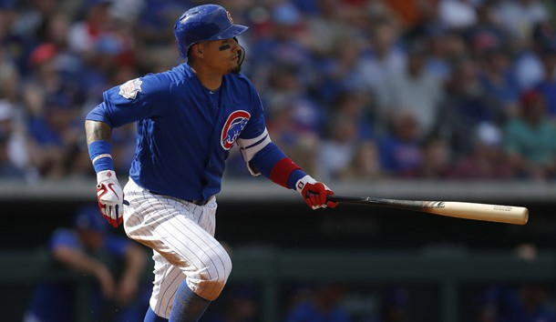 Mar 5, 2019; Tempe, AZ, USA; Chicago Cubs shortstop Javier Baez (9) hits a single against the Kansas City Royals in the fourth inning during a spring training game at Tempe Diablo Stadium. Photo Credit: Rick Scuteri-USA TODAY Sports
