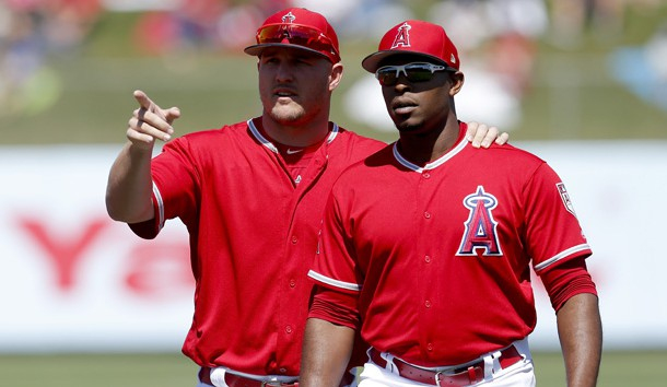 Mar 22, 2019; Tempe, AZ, USA; Los Angeles Angels center fielder Mike Trout (27) and Justin Upton (8) before a spring training game against the Chicago White Sox at Tempe Diablo Stadium. Photo Credit: Rick Scuteri-USA TODAY Sports