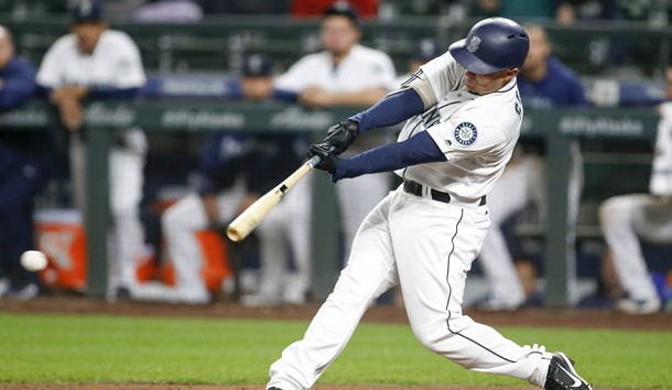 Sep 25, 2018; Seattle, WA, USA; Seattle Mariners third baseman Kyle Seager (15) hits an RBI-single against the Oakland Athletics during the ninth inning at Safeco Field. Photo Credit: Joe Nicholson-USA TODAY Sports