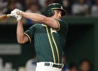 A's Olson exits with hand injury
