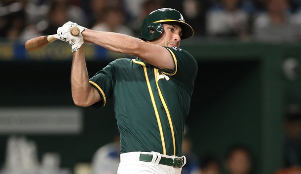Mar 17, 2019; Tokyo, Japan; Oakland Athletics first baseman Matt Olson (28) follows-through on a base hit during the third inning against the Nippon Ham Fighters at Tokyo Dome. Photo Credit: Darren Yamashita-USA TODAY Sports