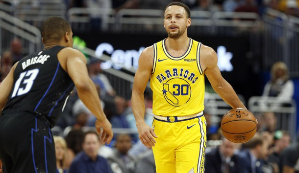 Feb 28, 2019; Orlando, FL, USA; Golden State Warriors guard Stephen Curry (30) drives to the basket as Orlando Magic guard Isaiah Briscoe (13) defends during the first quarter at Amway Center. Photo Credit: Kim Klement-USA TODAY Sports