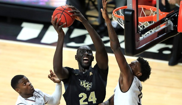 Feb 21, 2019; Cincinnati, OH, USA; UCF Knights center Tacko Fall (24) drives to the basket against Cincinnati Bearcats center Nysier Brooks (33) and forward Trevon Scott (13) in the second half at Fifth Third Arena. Photo Credit: Aaron Doster-USA TODAY Sports