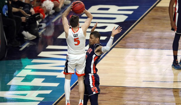 Apr 6, 2019; Minneapolis, MN, USA; Virginia Cavaliers guard Kyle Guy (5) is fouled by Auburn Tigers guard Samir Doughty (10) during the second half in the semifinals of the 2019 men's Final Four at US Bank Stadium. Photo Credit: Brace Hemmelgarn-USA TODAY Sports