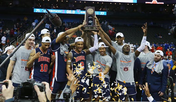 Mar 31, 2019; Kansas City, MO, United States; Auburn Tigers players celebrate with the trophy after defeating the Kentucky Wildcats in the championship game of the midwest regional of the 2019 NCAA Tournament at Sprint Center. Photo Credit: Jay Biggerstaff-USA TODAY Sports