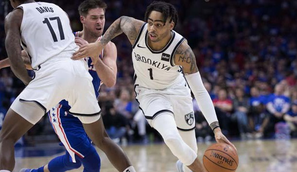 Apr 13, 2019; Philadelphia, PA, USA; Brooklyn Nets guard D'Angelo Russell (1) dribbles past Philadelphia 76ers guard T.J. McConnell (12) during the fourth quarter in game one of the first round of the 2019 NBA Playoffs at Wells Fargo Center. Photo Credit: Bill Streicher-USA TODAY Sports