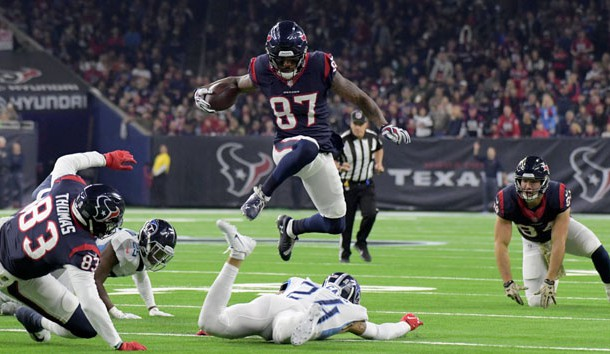 Nov 26, 2018; Houston, TX, USA; Houston Texans wide receiver Demaryius Thomas (87) leaps over Tennessee Titans strong safety Kenny Vaccaro (24) during the first half at NRG Stadium. Photo Credit: Kirby Lee-USA TODAY Sports