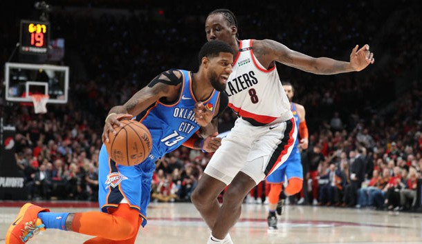 Apr 14, 2019; Portland, OR, USA; Oklahoma City Thunder forward Paul George (13) moves against Portland Trail Blazers forward Al-Farouq Aminu (8) in the first half in game one of the first round of the 2019 NBA Playoffs at Moda Center. Photo Credit: Jaime Valdez-USA TODAY Sports