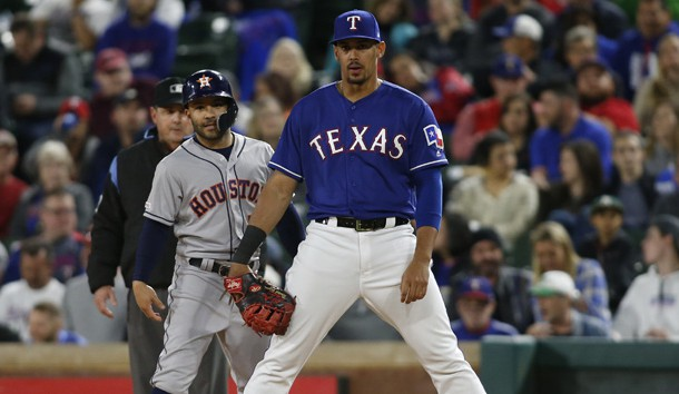 Apr 3, 2019; Arlington, TX, USA; Houston Astros second baseman Jose Altuve (left) stands on first base alongside Texas Rangers first baseman Ronald Guzman (right) after hitting a single in the eighth inning at Globe Life Park in Arlington. Photo Credit: Tim Heitman-USA TODAY Sports