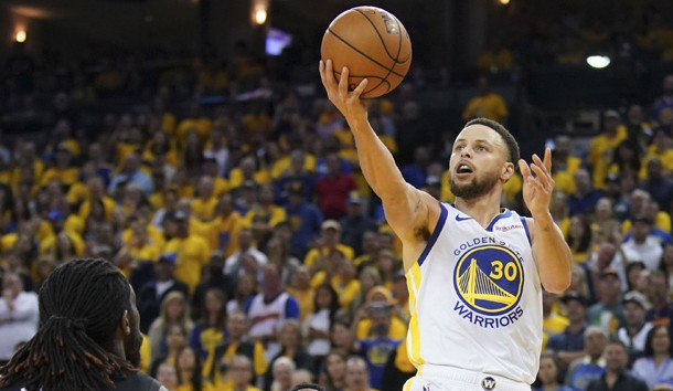 April 13, 2019; Oakland, CA, USA; Golden State Warriors guard Stephen Curry (30) shoots the basketball against LA Clippers forward Montrezl Harrell (5) during the fourth quarter in game one of the first round of the 2019 NBA Playoffs at Oracle Arena. Photo Credit: Kyle Terada-USA TODAY Sports