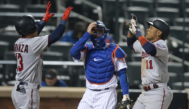 Apr 9, 2019; New York City, NY, USA; Minnesota Twins shortstop Jorge Polanco (11) celebrates his two run home run with shortstop Ehire Adrianza (13) in front of New York Mets catcher Travis d'Arnaud (18) during the eighth inning at Citi Field. Photo Credit: Brad Penner-USA TODAY Sports