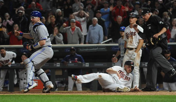Apr 16, 2019; Minneapolis, MN, USA;  Toronto Blue Jays catcher Danny Jansen (9) celebrates the win after tagging out Minnesota Twins first baseman C.J. Cron (24) at home plate for the final out of the game during the ninth inning at Target Field. Photo Credit: Marilyn Indahl-USA TODAY Sports