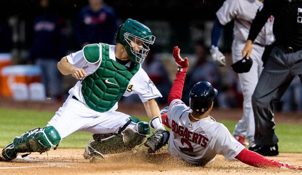 Apr 1, 2019; Oakland, CA, USA; Oakland Athletics catcher Nick Hundley (3) tags Boston Red Sox shortstop Xander Bogaerts (2) in a contested call that was upheld in the second inning at Oakland Coliseum. Photo Credit: John Hefti-USA TODAY Sports