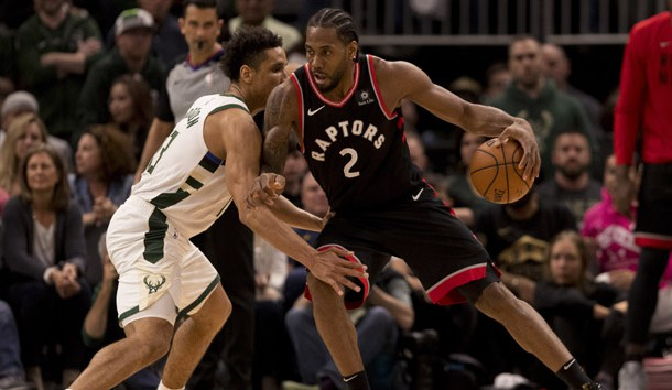 May 15, 2019; Milwaukee, WI, USA; Toronto Raptors forward Kawhi Leonard (2) drives for the basket against Milwaukee Bucks guard Malcolm Brogdon (13) during the fourth quarter in game one of the Eastern conference finals of the 2019 NBA Playoffs at Fiserv Forum. Photo Credit: Jeff Hanisch-USA TODAY Sports