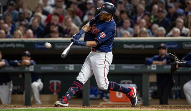 May 28, 2019; Minneapolis, MN, USA; Minnesota Twins right fielder Eddie Rosario (20) hits a two-run home run during the seventh inning against the Milwaukee Brewers at Target Field. Photo Credit: Jordan Johnson-USA TODAY Sports