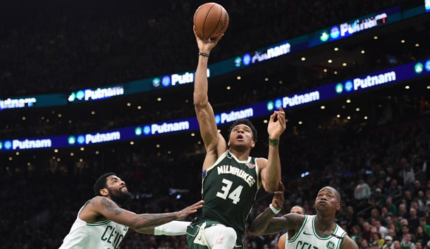 May 3, 2019; Boston, MA, USA; Milwaukee Bucks forward Giannis Antetokounmpo (34) drives to the basket against Boston Celtics guard Kyrie Irving (11) and guard Terry Rozier (12) during the second half in game three of the second round of the 2019 NBA Playoffs at TD Garden. Photo Credit: Bob DeChiara-USA TODAY Sports