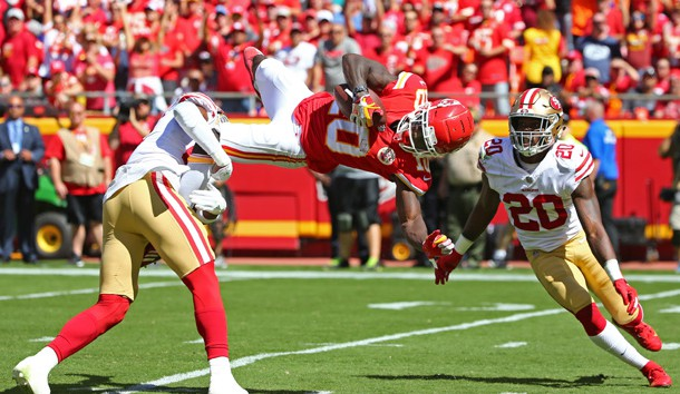 Sep 23, 2018; Kansas City, MO, USA; Kansas City Chiefs wide receiver Tyreek Hill (10) catches a pass as San Francisco 49ers cornerbacks Jimmie Ward (20) and Adrian Colbert (27) defend in the first half at Arrowhead Stadium. Photo Credit: Jay Biggerstaff-USA TODAY Sports