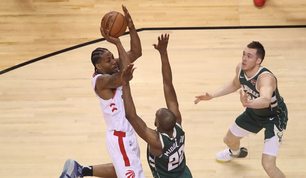 May 19, 2019; Toronto, Ontario, CAN; Toronto Raptors forward Kawhi Leonard (2) shoots the ball in the second quarter as Milwaukee Bucks forward Khris Middleton (22) defends in game three of the Eastern conference finals of the 2019 NBA Playoffs at Scotiabank Arena. Photo Credit: Tom Szczerbowski-USA TODAY Sports