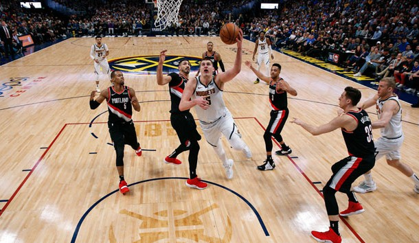 Apr 29, 2019; Denver, CO, USA; Denver Nuggets center Nikola Jokic (15) shoots the ball past Portland Trail Blazers guard Rodney Hood (5), center Enes Kanter (00), guard CJ McCollum (3) and forward Zach Collins (33) in front of Nuggets forward Mason Plumlee (24) in the third quarter in game one of the second round of the 2019 NBA Playoffs at the Pepsi Center. Mandatory Credit: Isaiah J. Downing-USA TODAY Sports
